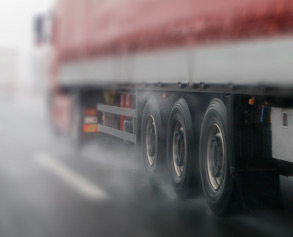 Truck wheels on highway in rain